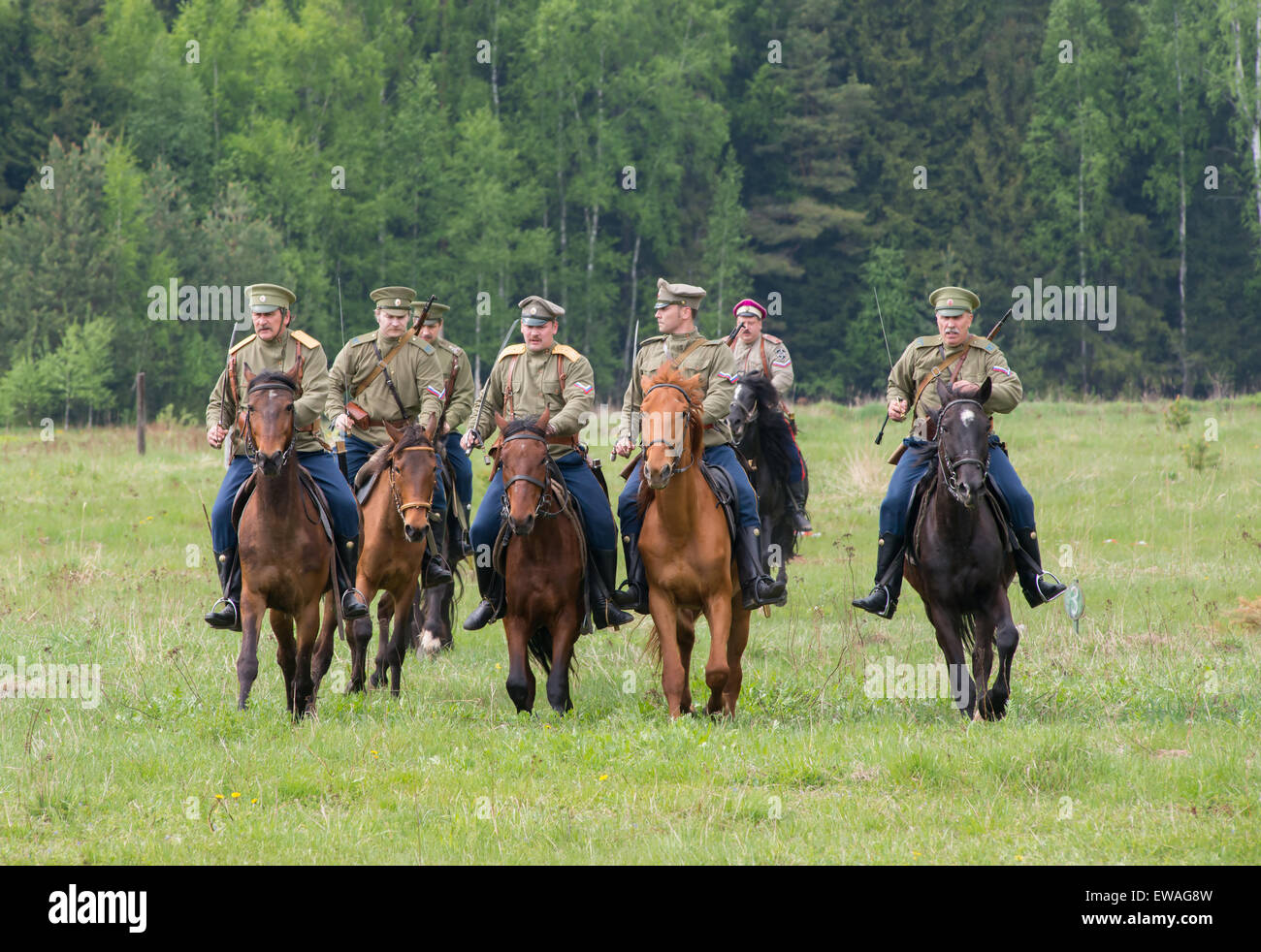 RUSSIA, CHERNOGOLOVKA - MAY 17: Cavalry soldiers ride on horses across the field on History reenactment of battle - Stock Image