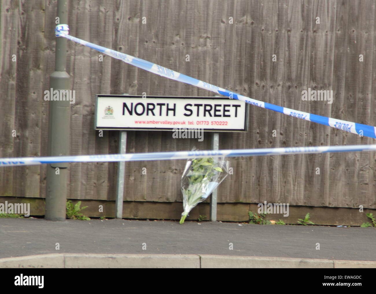 Langley Mill, Derbyshire. 21 June 2015. A floral tribute is left on North Street, Langley Mill following a house - Stock Image