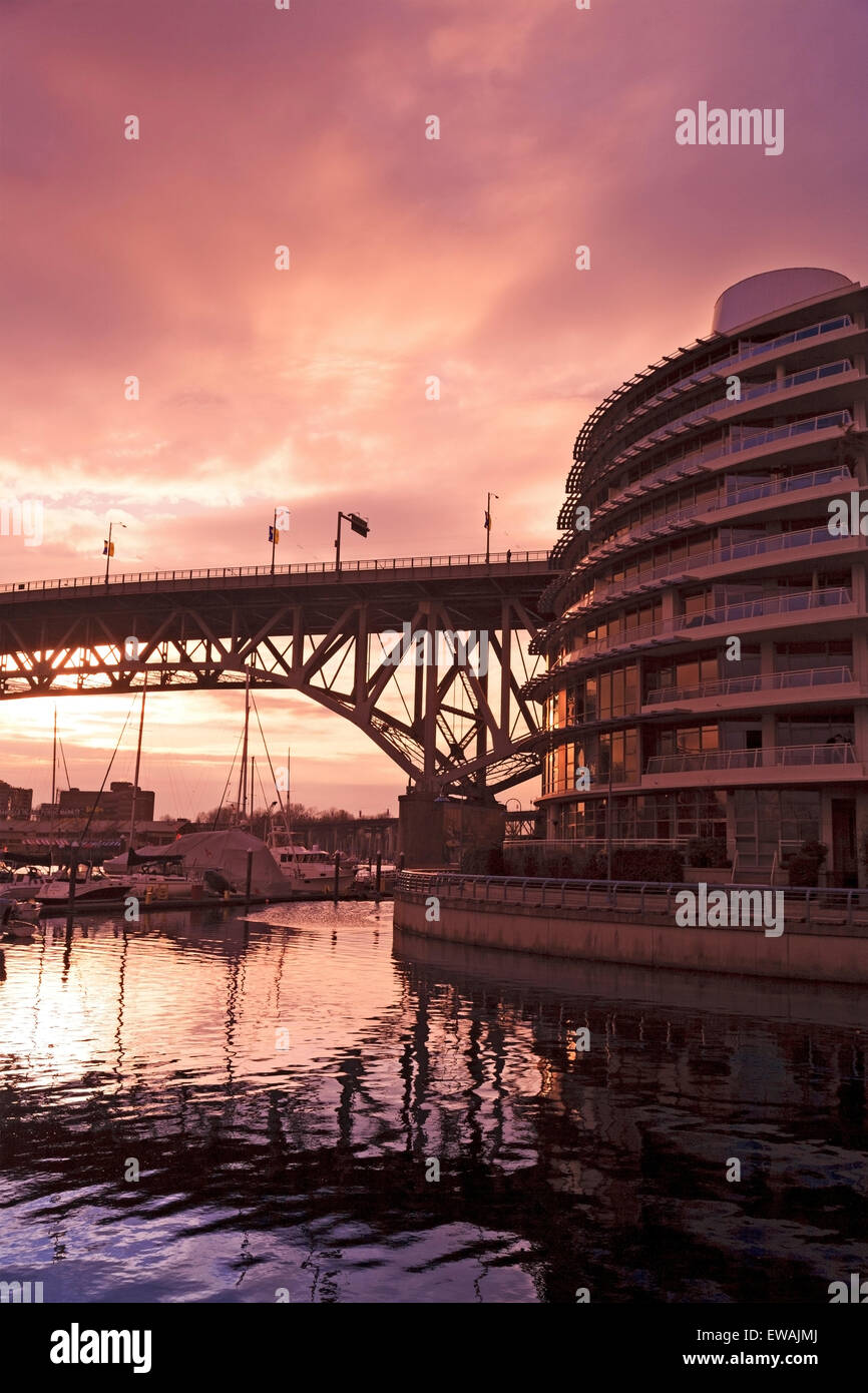 Condominium tower along False Creek near Burrard Street bridge, Vancouver, BC - Stock Image