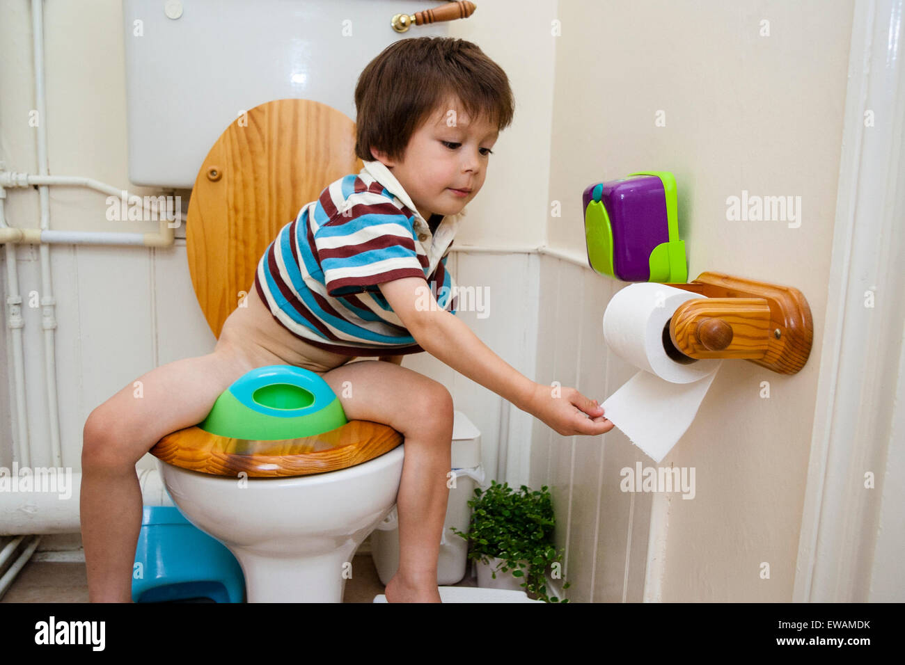 3 To 5 Year Old Caucasian Boy Sitting On Toilet Seat