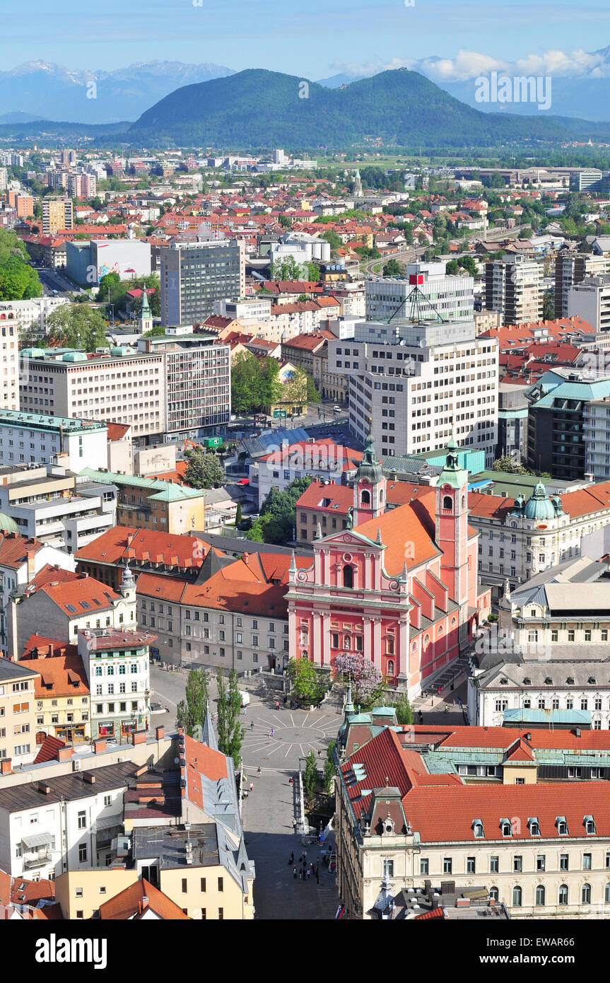 Aerial view of Slovenian capital Ljubljana with Smarna gora hill in the background - Stock Image