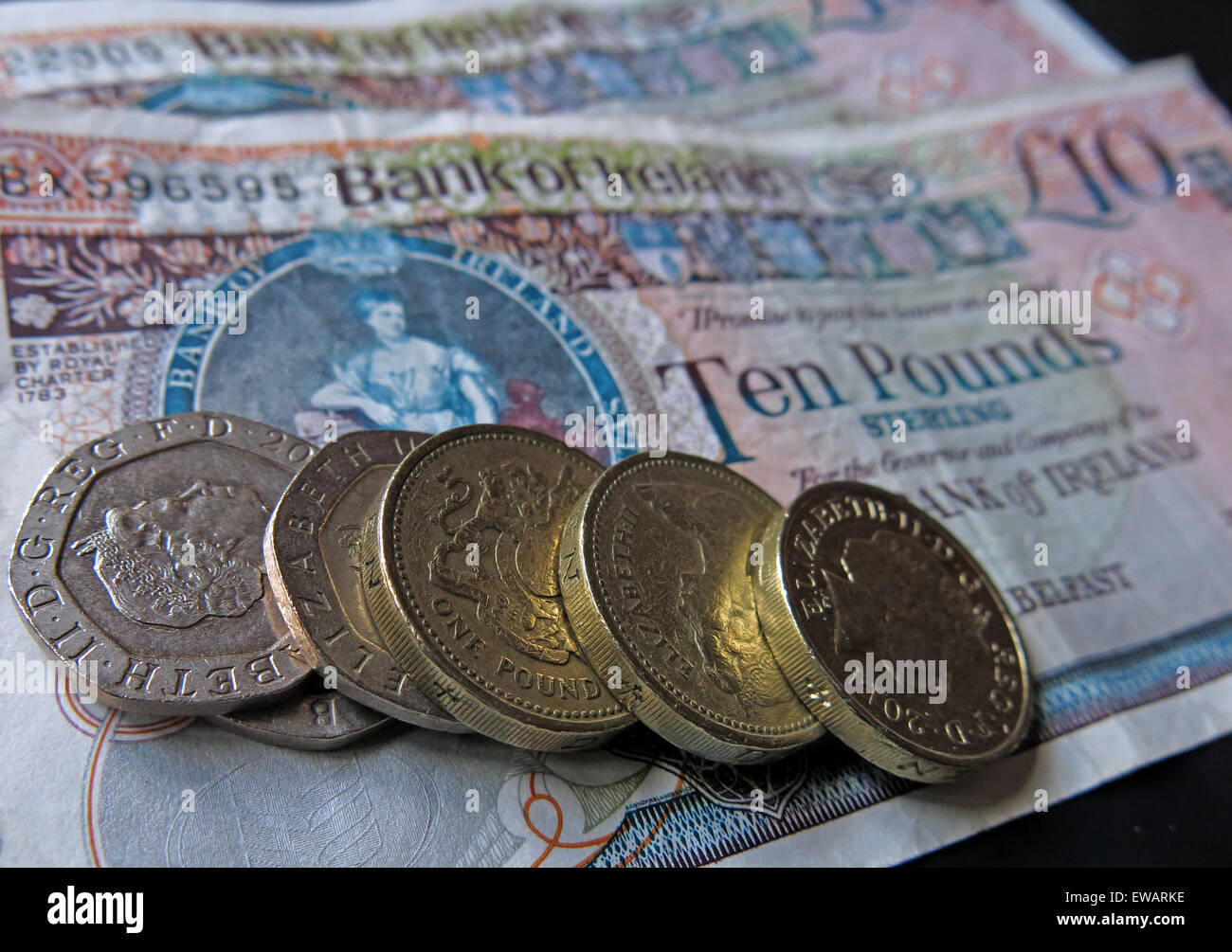 Northern Irish £5, £10 notes and pound coins, legal tender from the Bank Of Ireland  Belfast - Stock Image
