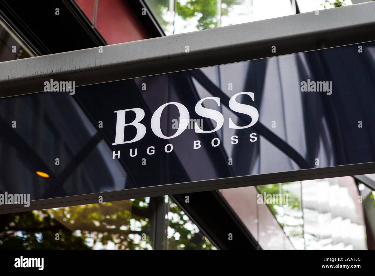 LONDON, UK - JUNE 10TH 2015: A sign on the shopfront of a Hugo Boss retail outlet in central London, on 10th June - Stock Image