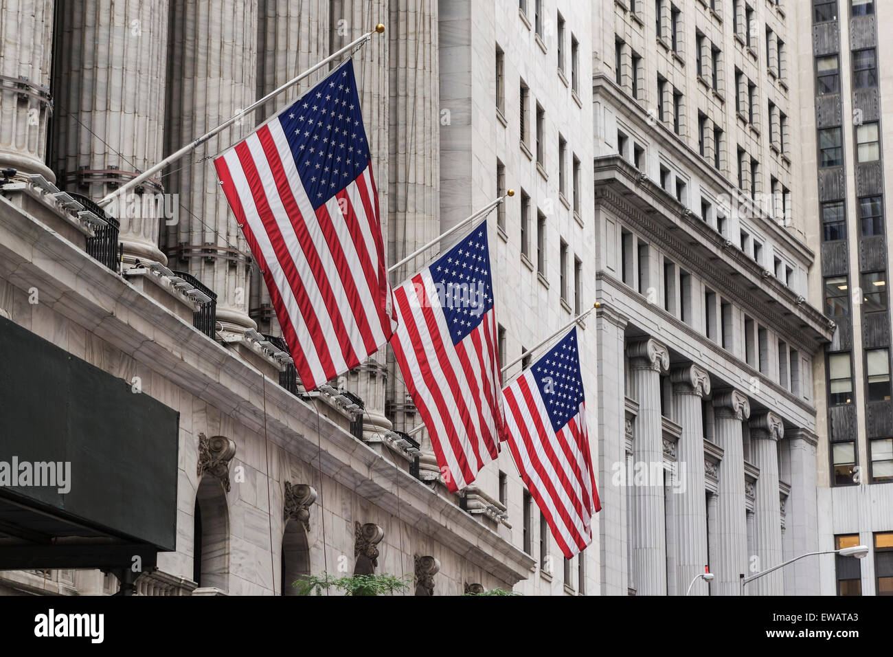 American flags at wallstreet, The New York Stock Exchange on Wall Street, NYC, lower Manhattan, United states. - Stock Image