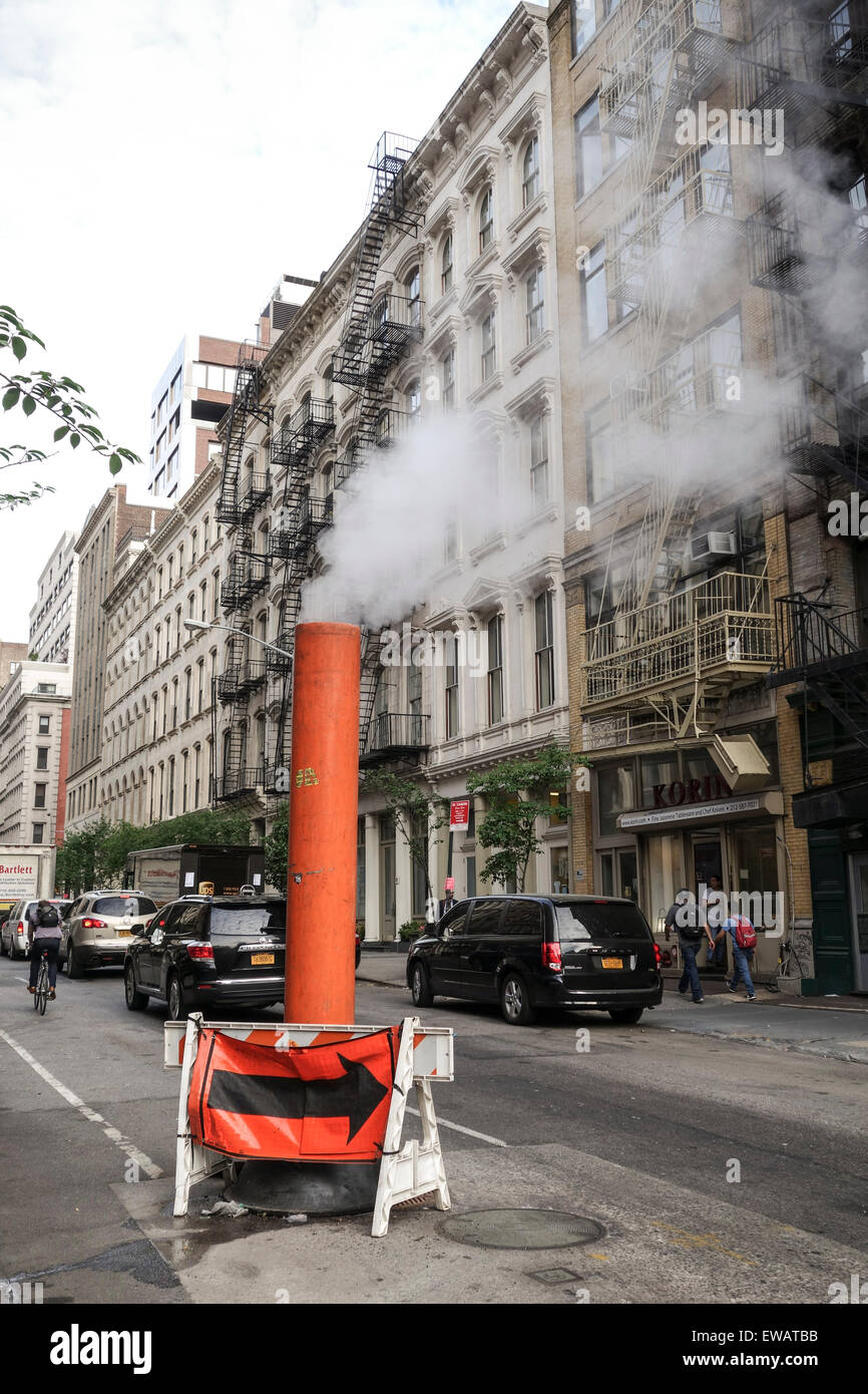 Steam vapor being vented in the streets of Manhattan, New york city, USA. - Stock Image