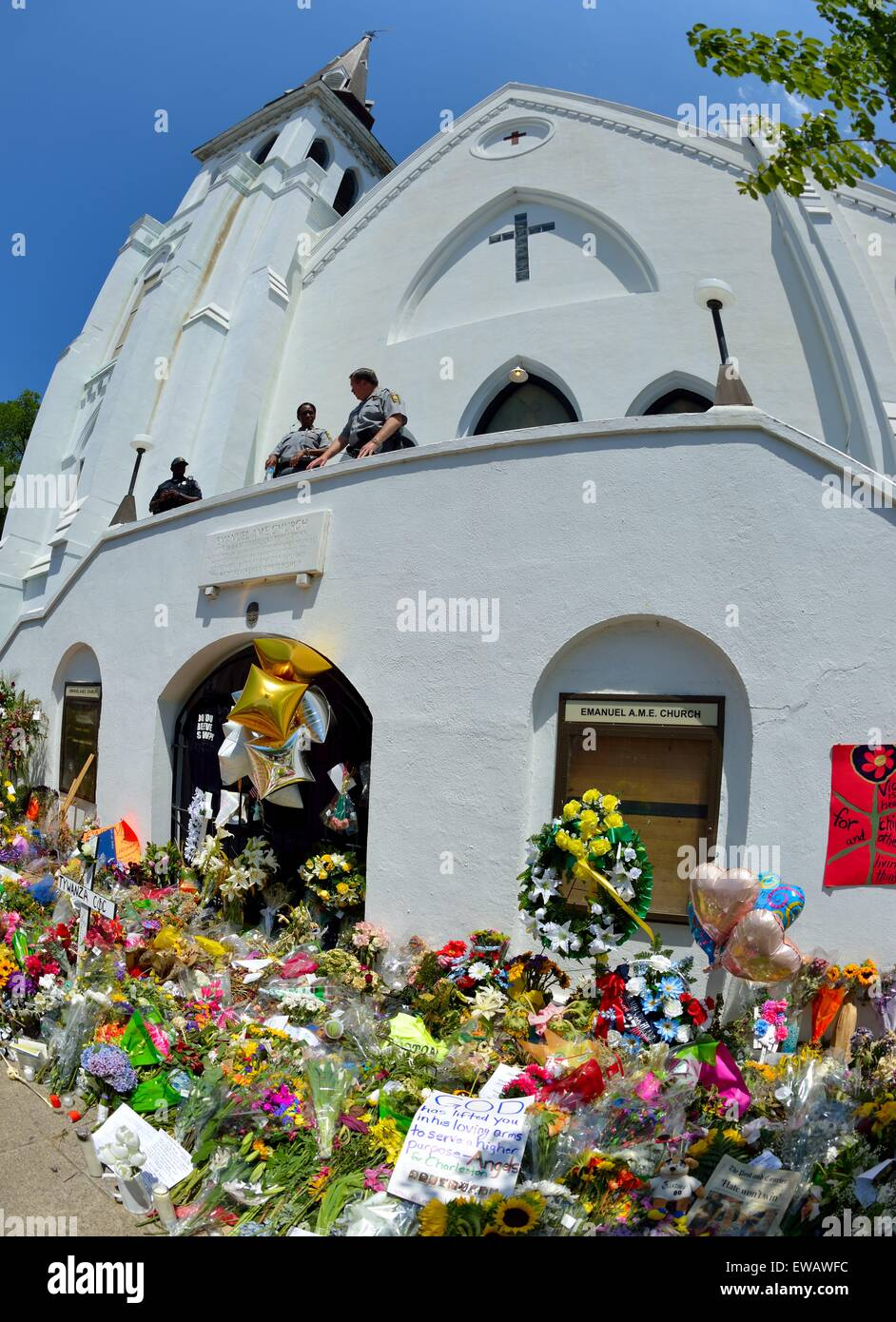 Flowers, signs and other tributes to nine victims of a violent rampage in front of the AME church in Charleston, - Stock Image