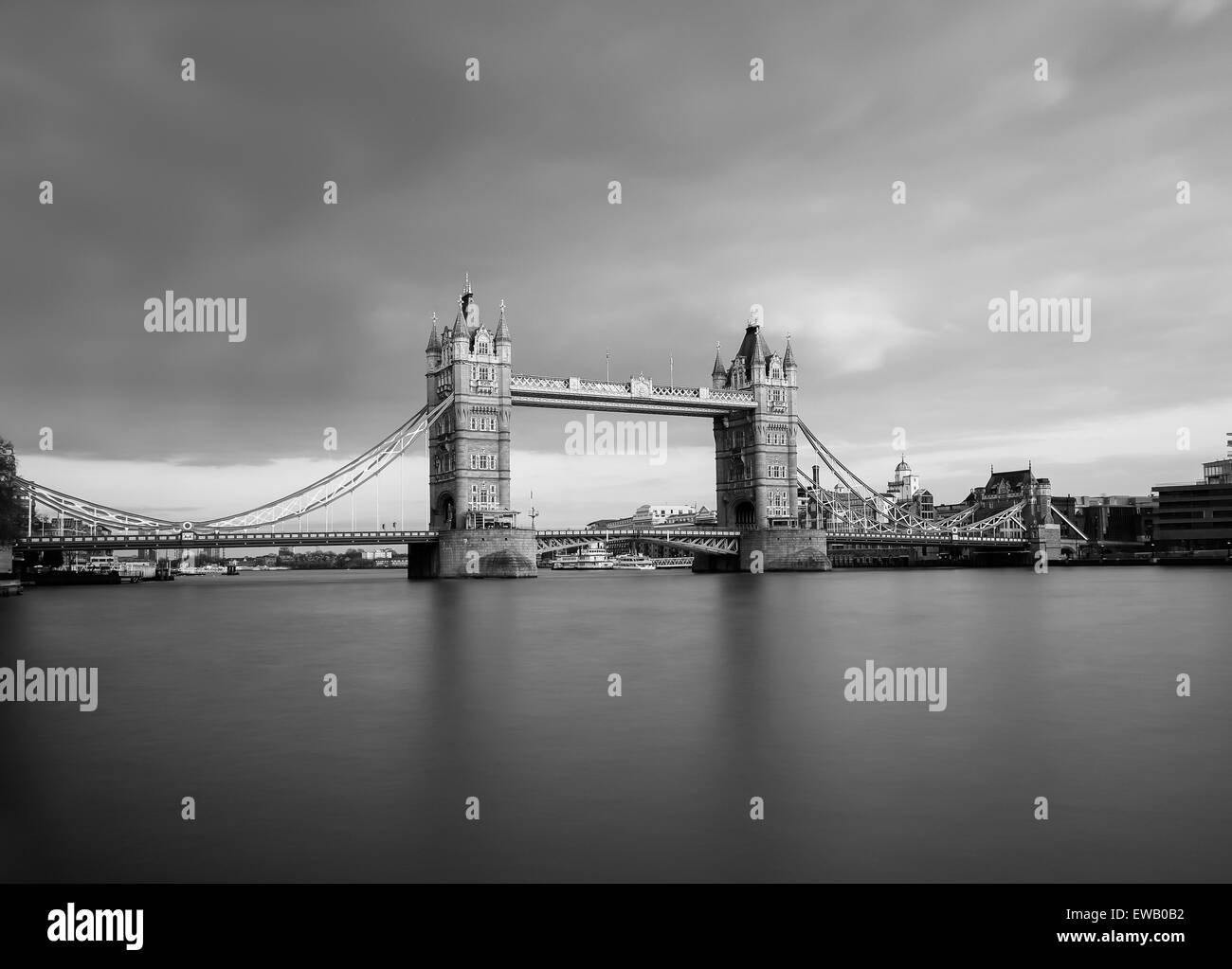 Tower Bridge in black and white taken with a long exposure. There is copy space on the image. - Stock Image