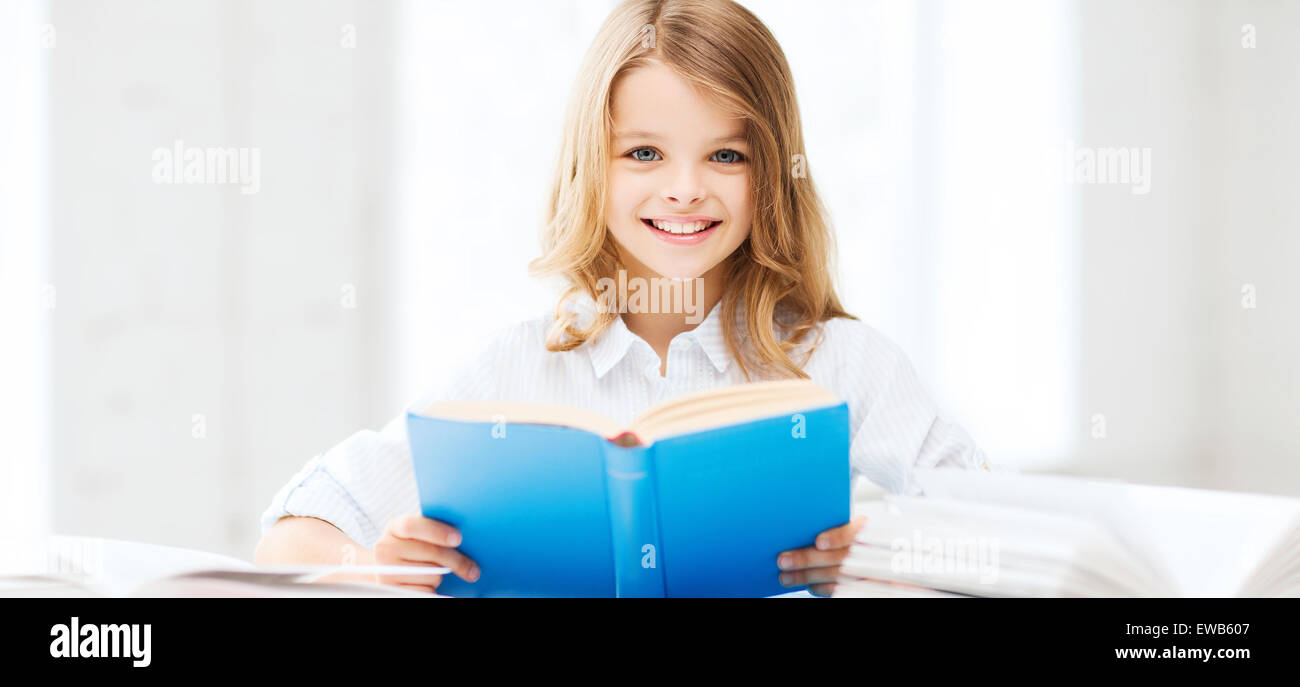 student girl studying at school - Stock Image