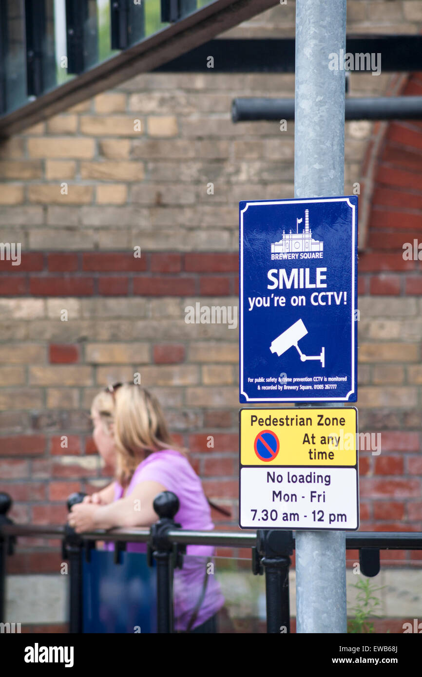 Smile you're on CCTV sign and Pedestrian Zone and No Loading signs at Brewery Square, Dorchester South, Dorset - Stock Image