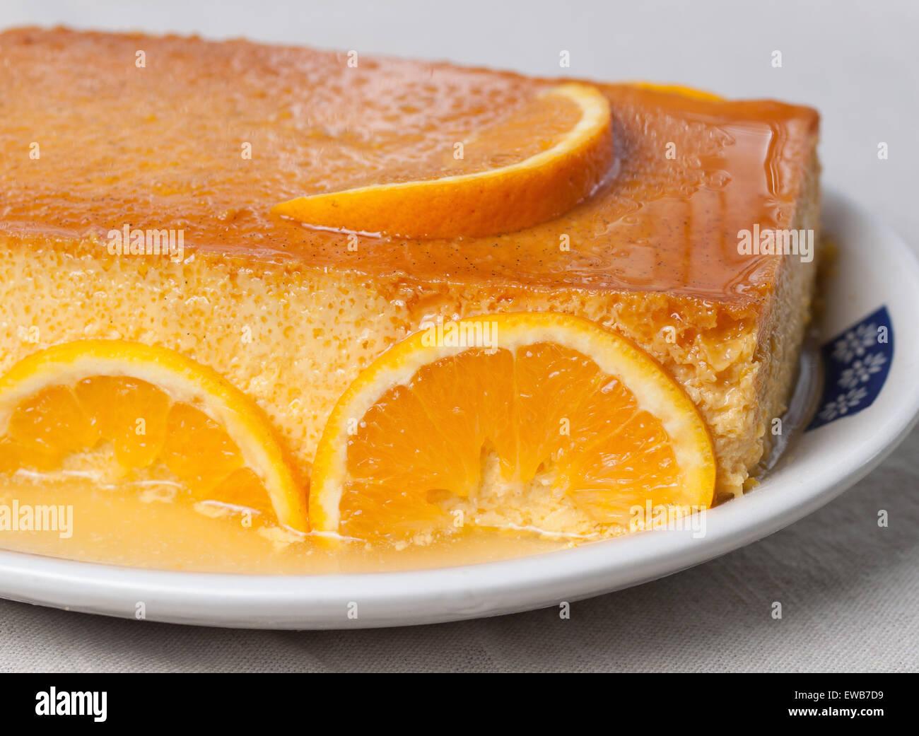 Orange custard in a studio shot. A delicious dessert. - Stock Image