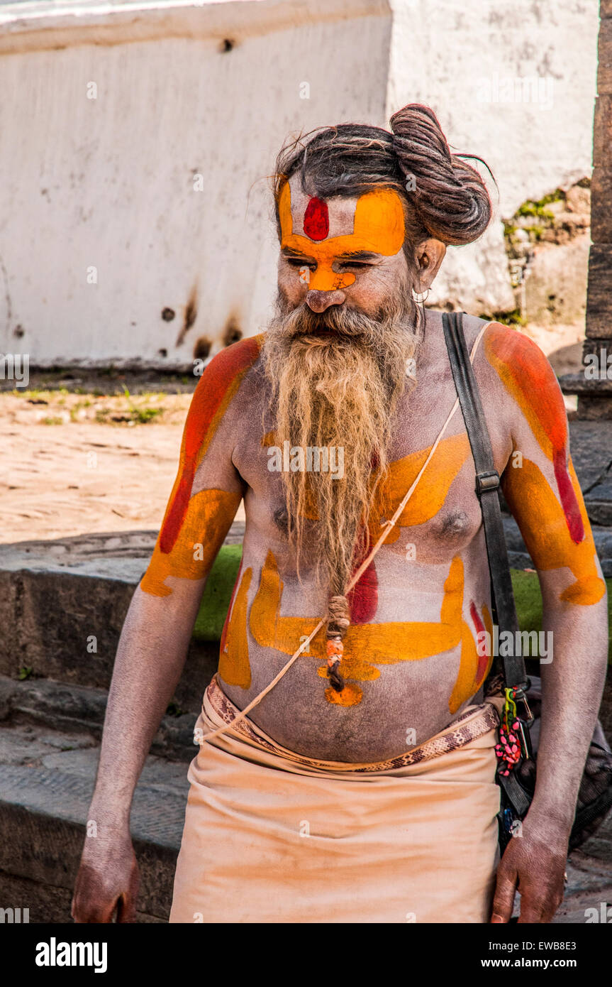 A Sadhu an ascetic or practitioner of yoga (yogi) who has given up pursuit of the first three Hindu goals of life: - Stock Image