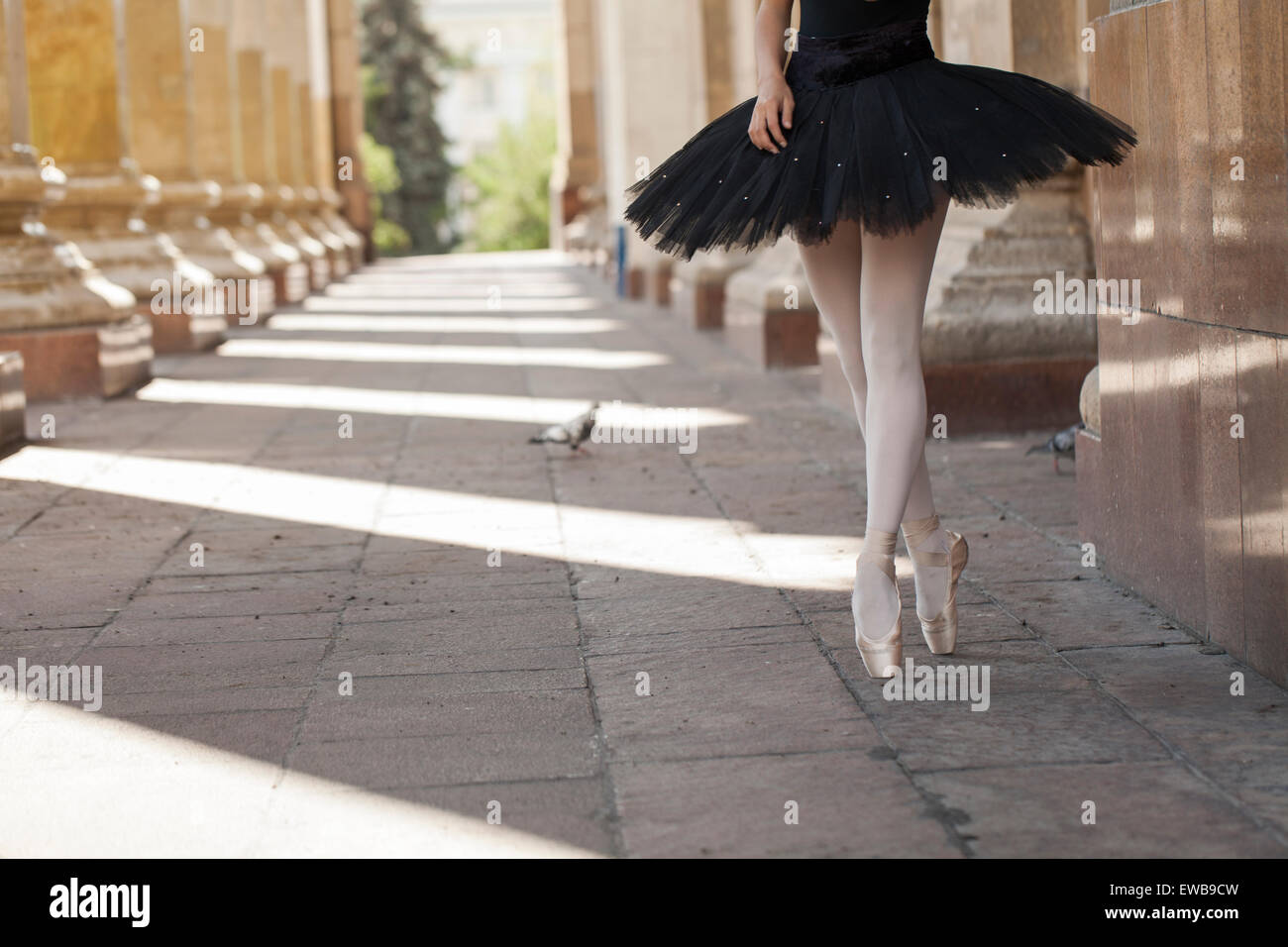 Girl ballerina flats standing on tiptoes - Stock Image