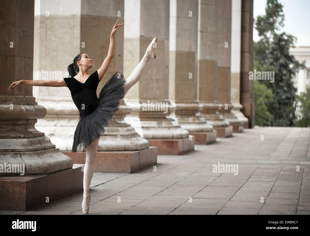 Girl ballerina flats standing on tiptoes on the street - Stock Image