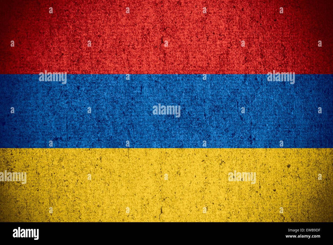 flag of Armenia or Armenian banner on rough pattern texture Stock Photo
