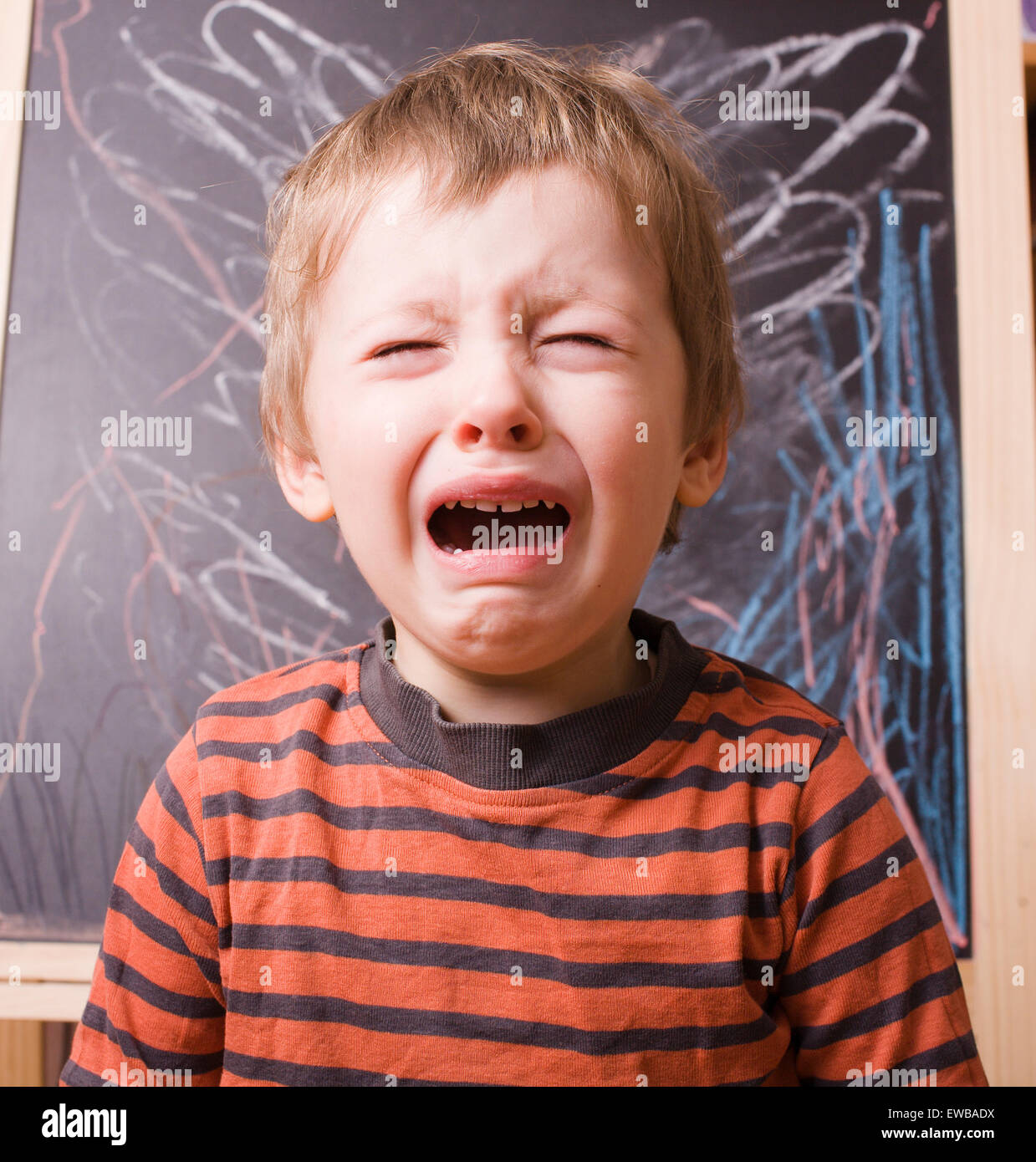 little cute boy screaming and crying at school stock photo 84457574
