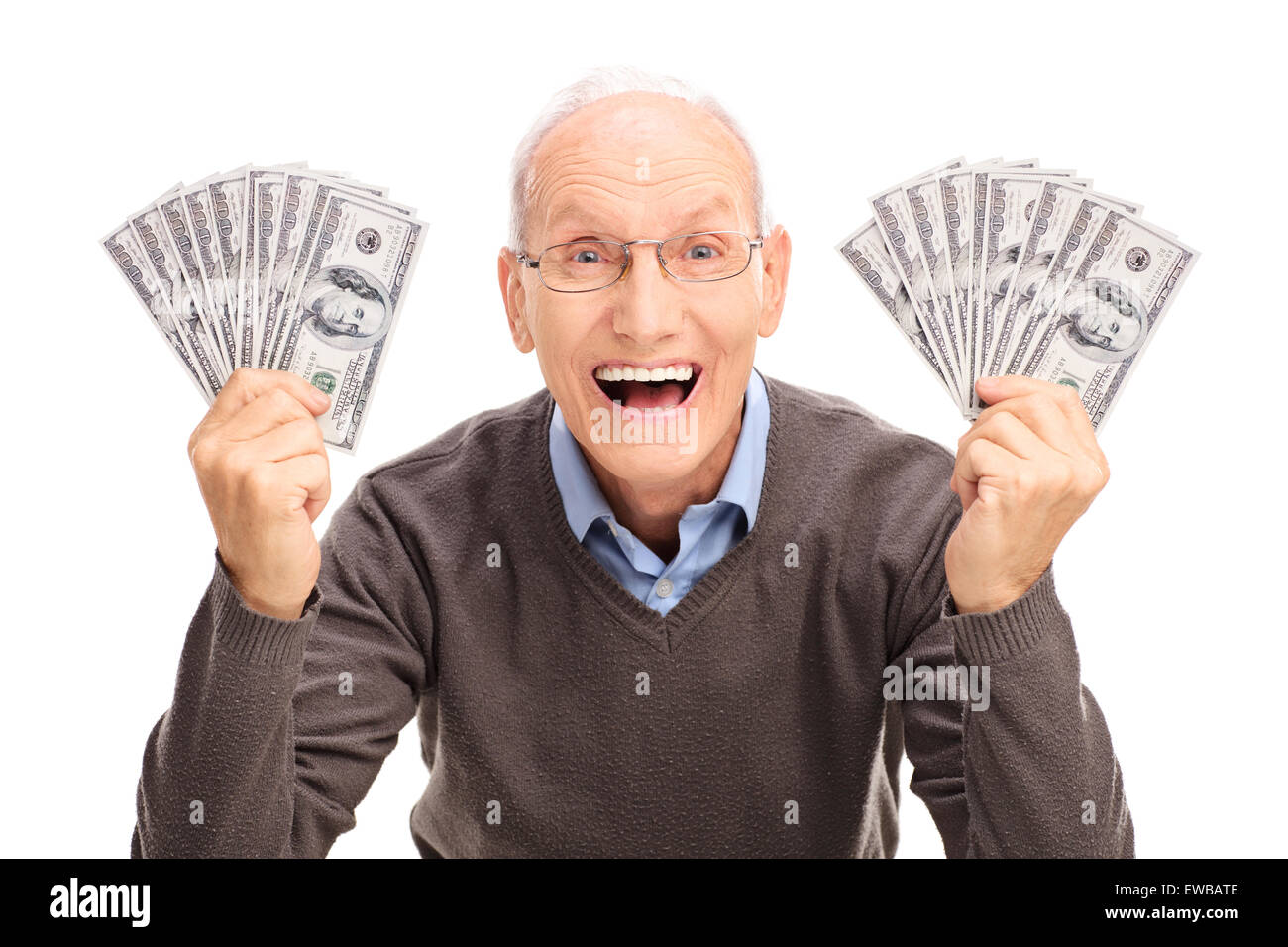 Studio shot of a joyful senior holding money in both hands and looking at the camera isolated on white background - Stock Image