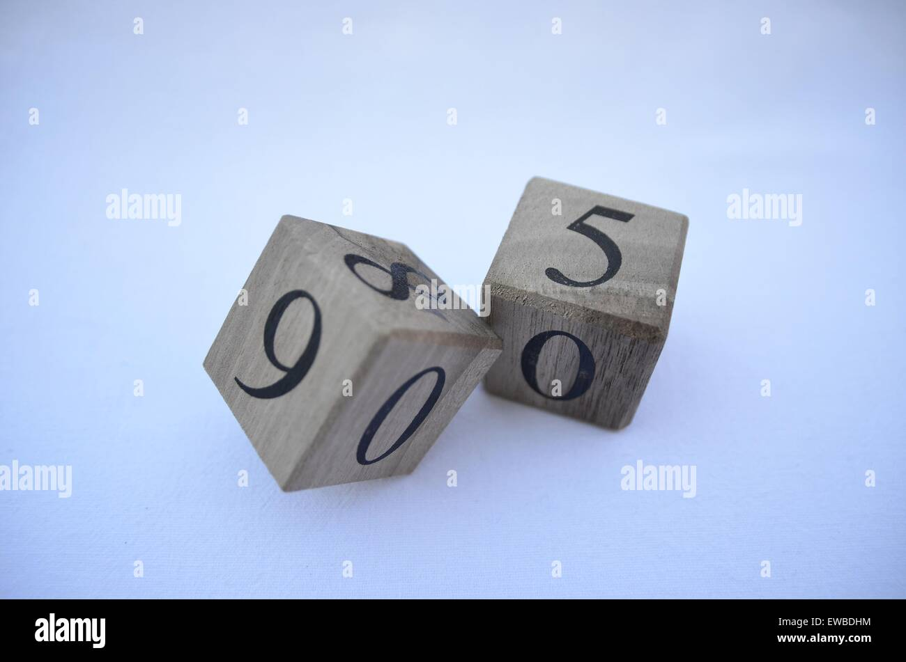 Numbers on wooden cubes - Stock Image