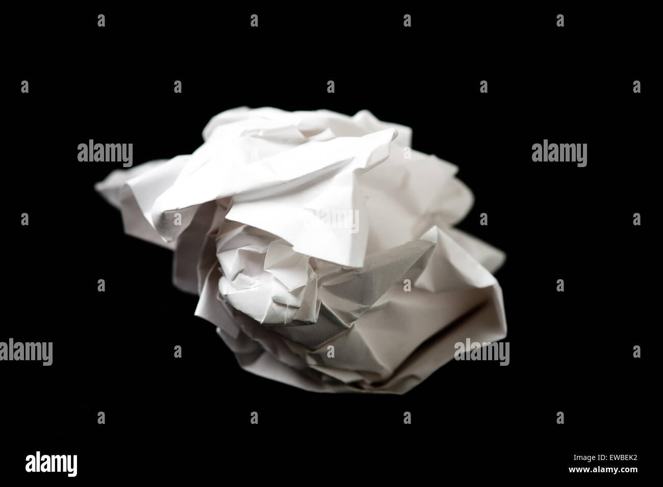 screwed up ball of paper - Stock Image