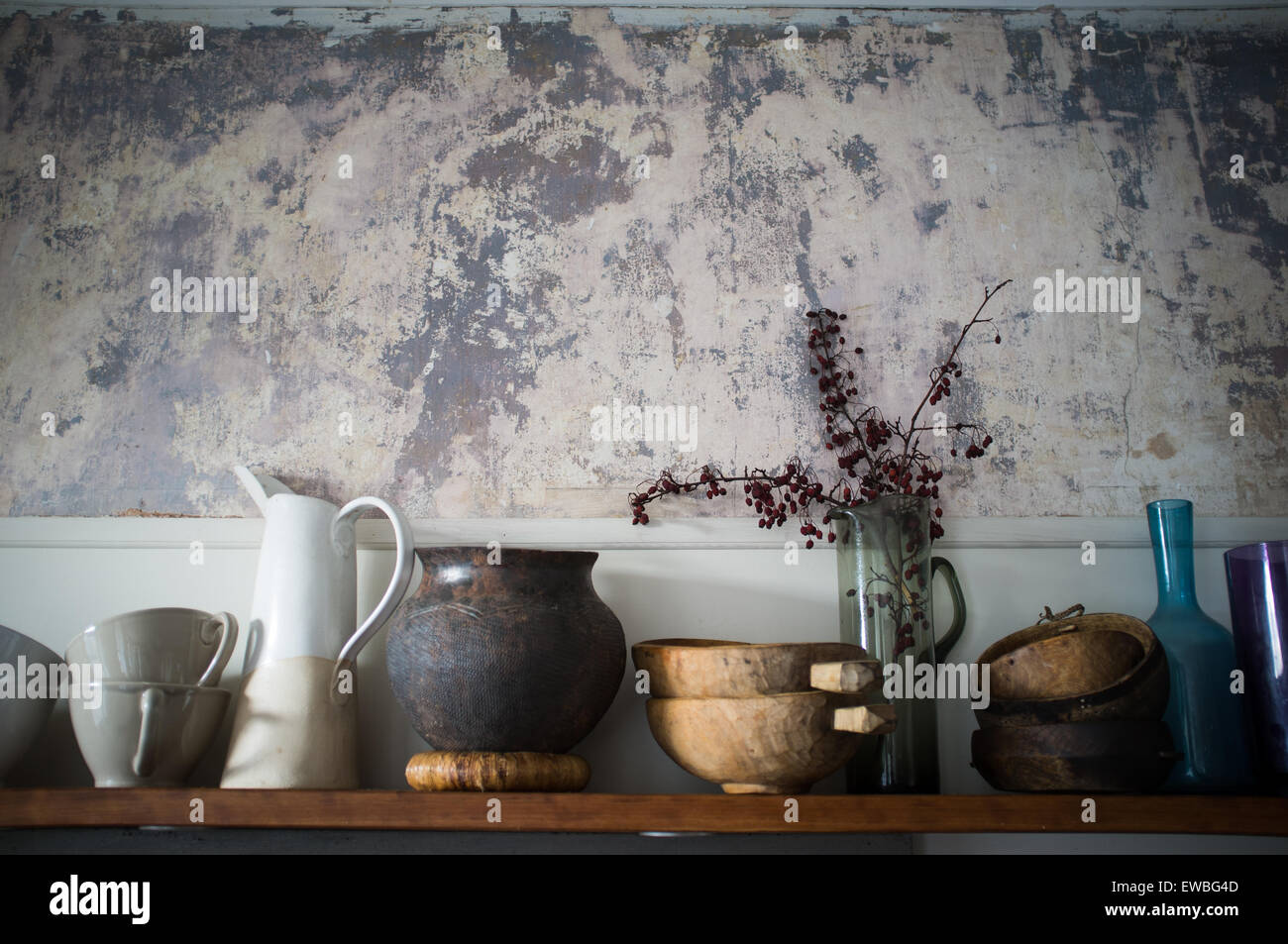 artful collection of vases and containers on kitchen shelf - Stock Image