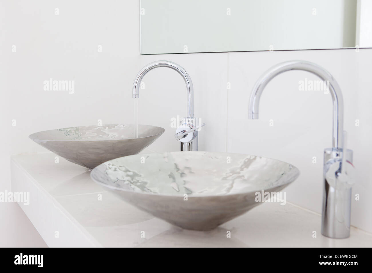 Modern bathroom with 'his and her' double sinks - Stock Image