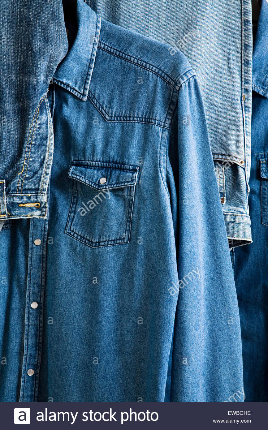 Selection of denim shirt and jeans - Stock Image
