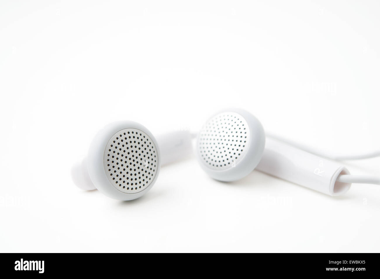 earbuds on white background - Stock Image