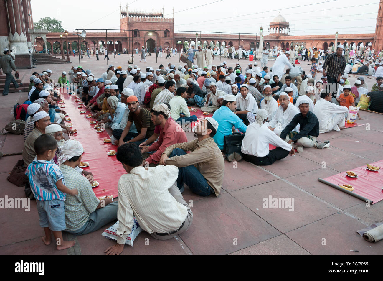 Traditional Iftar (fast-breaking) at Jama Masjid during Ramadan. Old Delhi, India. - Stock Image