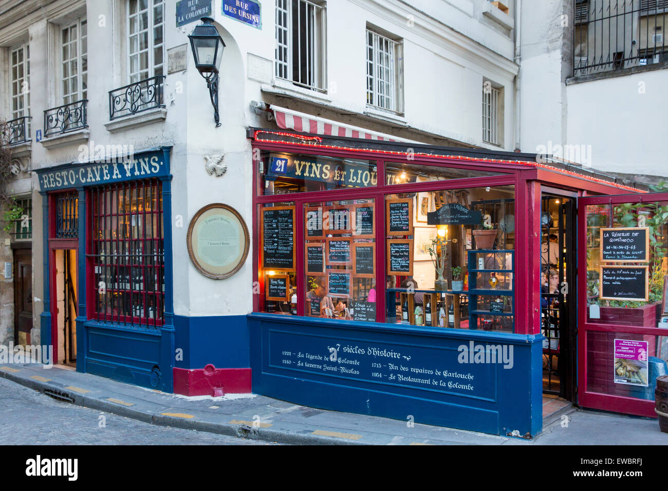 7 centuries of history along Rue de la Colombe, cafe and wine cellar on Ile de la Cite near Cathedral Notre Dame, - Stock Image