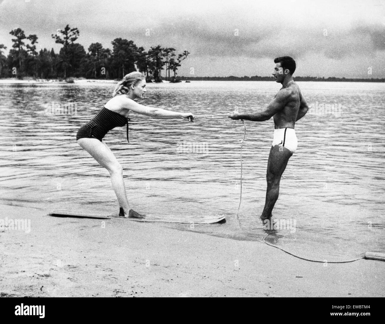 water ski lesson on the beach,1957 - Stock Image