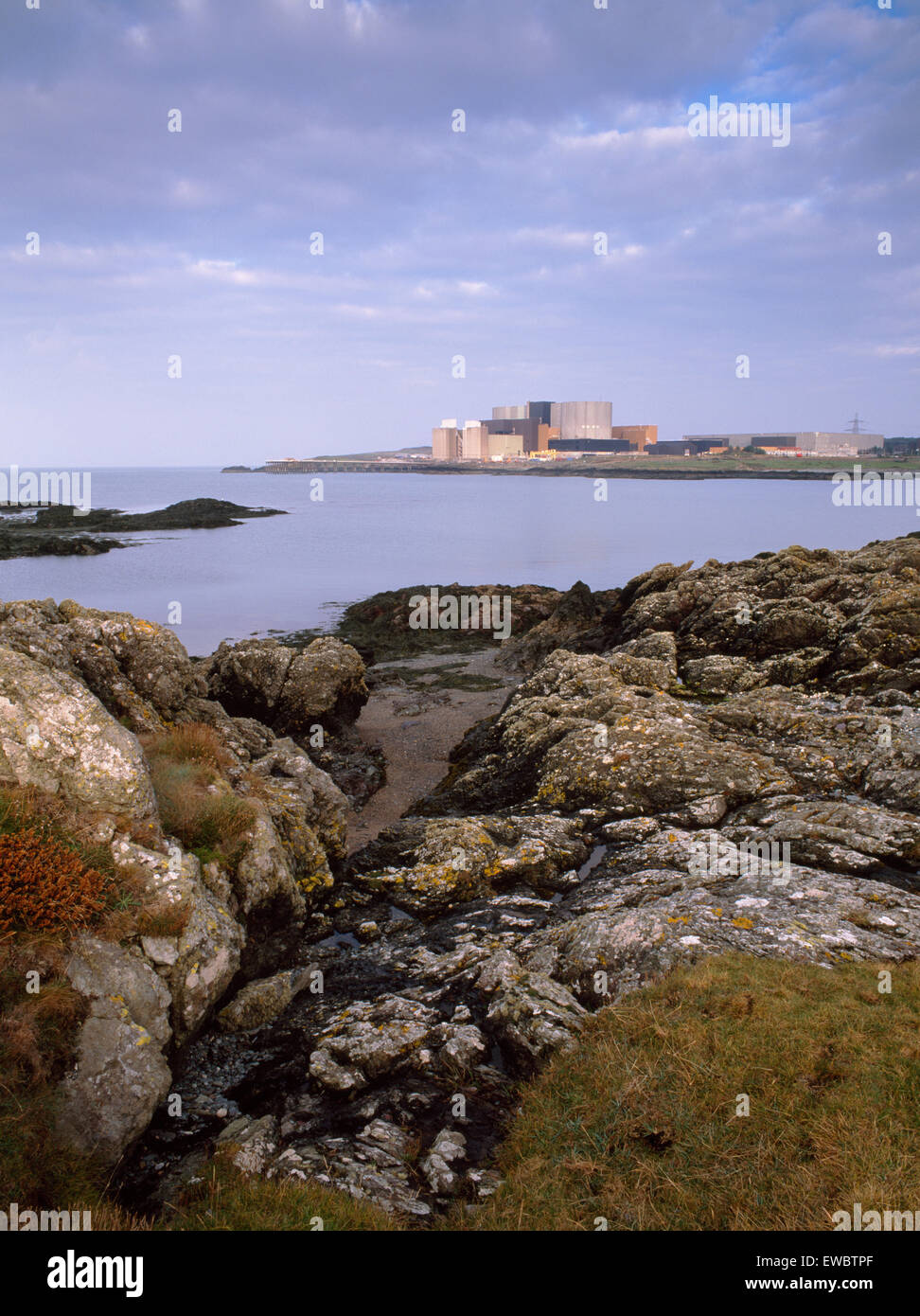 Wylfa Nuclear Power Station from the coastal path near Cemlyn Bay. - Stock Image