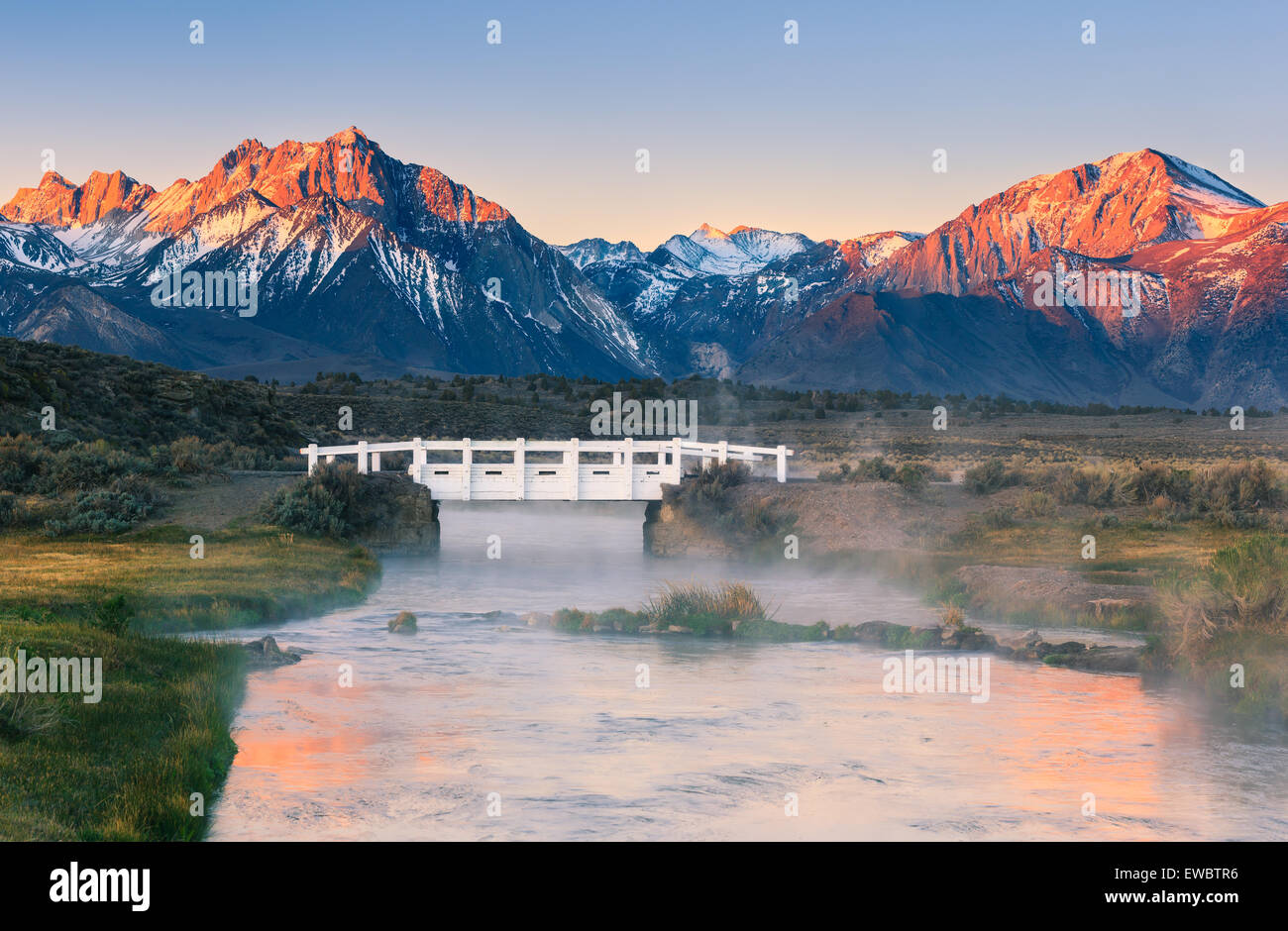 Sunrise on the Sierra Nevada seen from Hot Creek, California, USA. - Stock Image