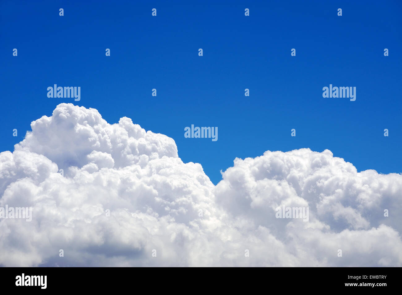Picture of cumulonimbus clouds on a blue sky on a warm summer afternoon - Stock Image