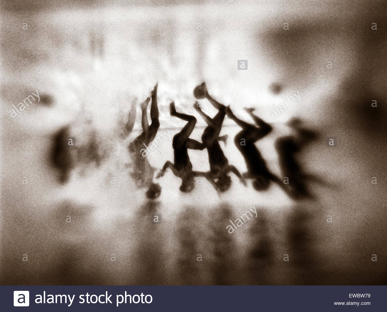 Synchronized swimmers seen underwater as they perform acrobats, Greece, Europe. - Stock Image