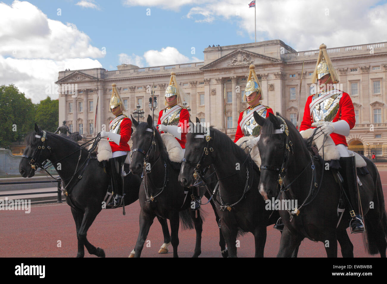 Mounted Royal Household Cavalry at Buckingham Palace in London - Stock Image