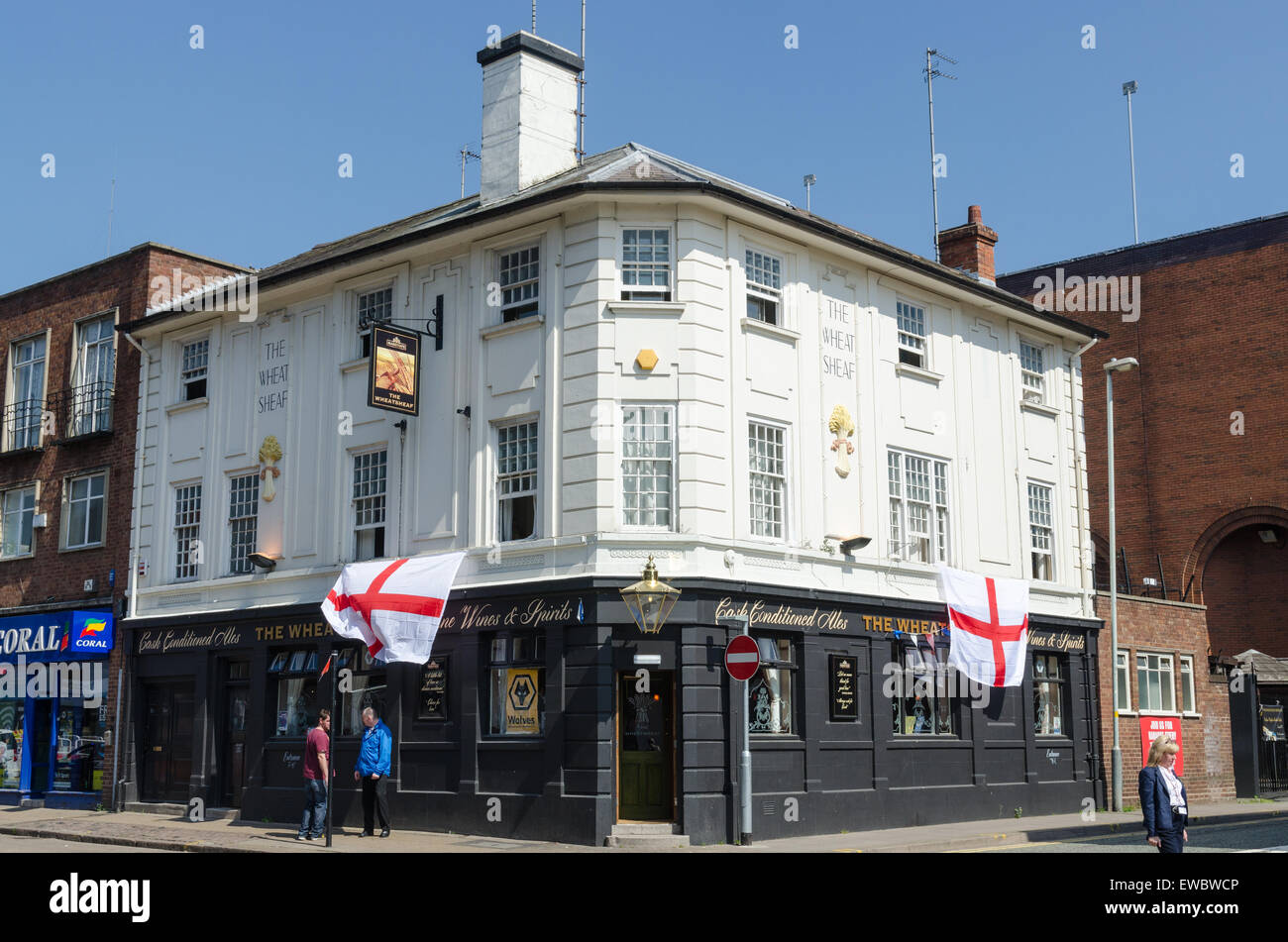Large Union Flags hanging on the Wheatsheaf public house in Wolverhampton - Stock Image