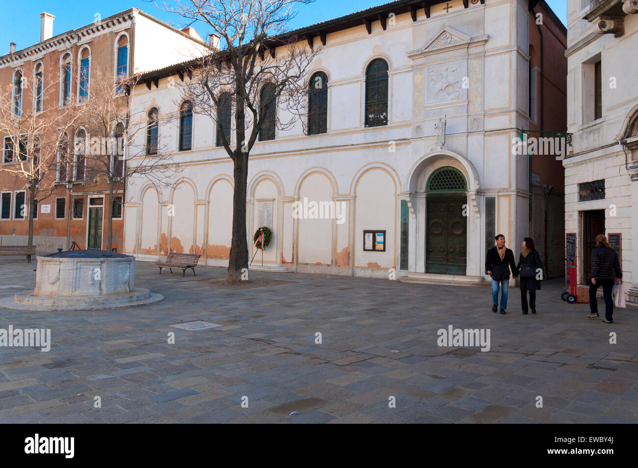 Campo San Vio Anglican church of St Georges and old well in the square in Venice Italy - Stock Image