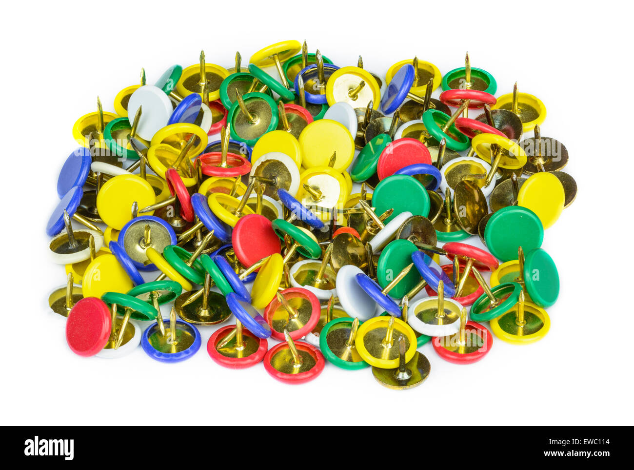 A pile of multicoloured drawing pins (thumb tacks) on a white background. - Stock Image
