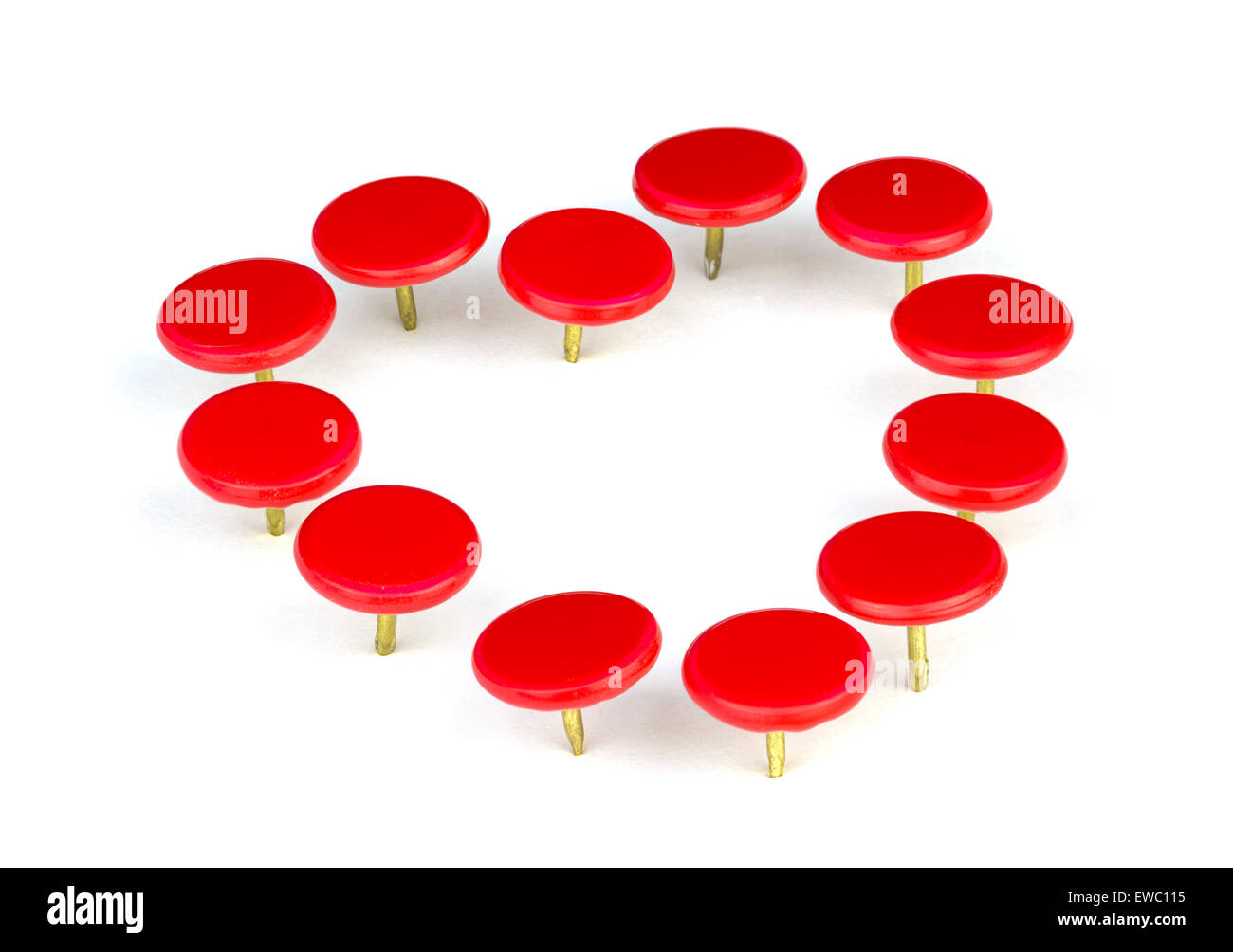 Love concept. Red drawing pins (thumbtacks) in the shape of a heart, on a white background. - Stock Image