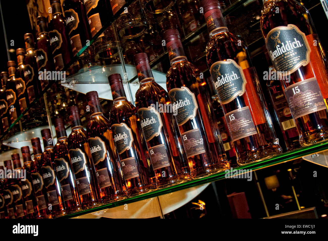 rows of Glenfiddich Whisky bottles 15 year old on a back bar - Stock Image