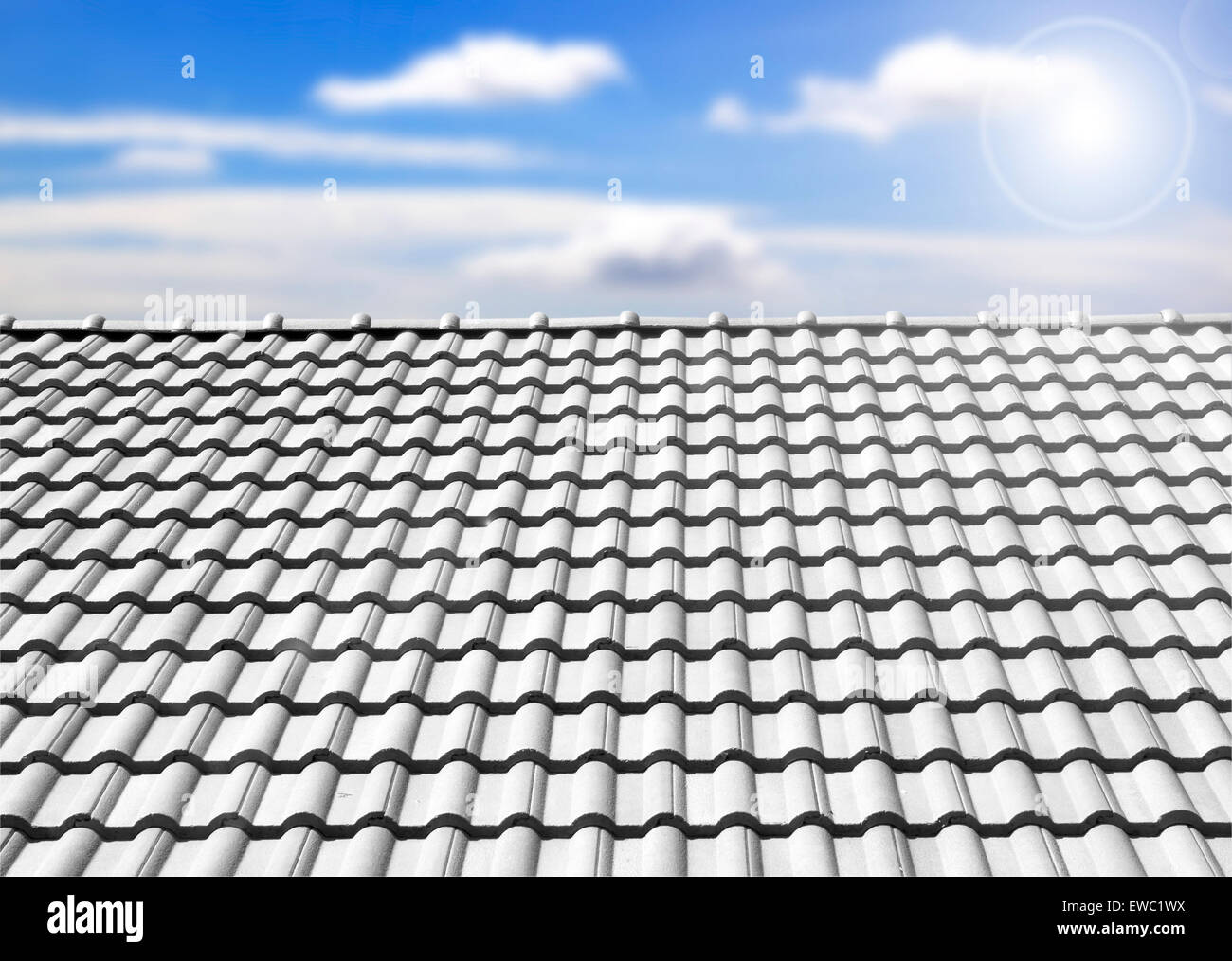 Brown tile roof in garden against blue sky. background - Stock Image