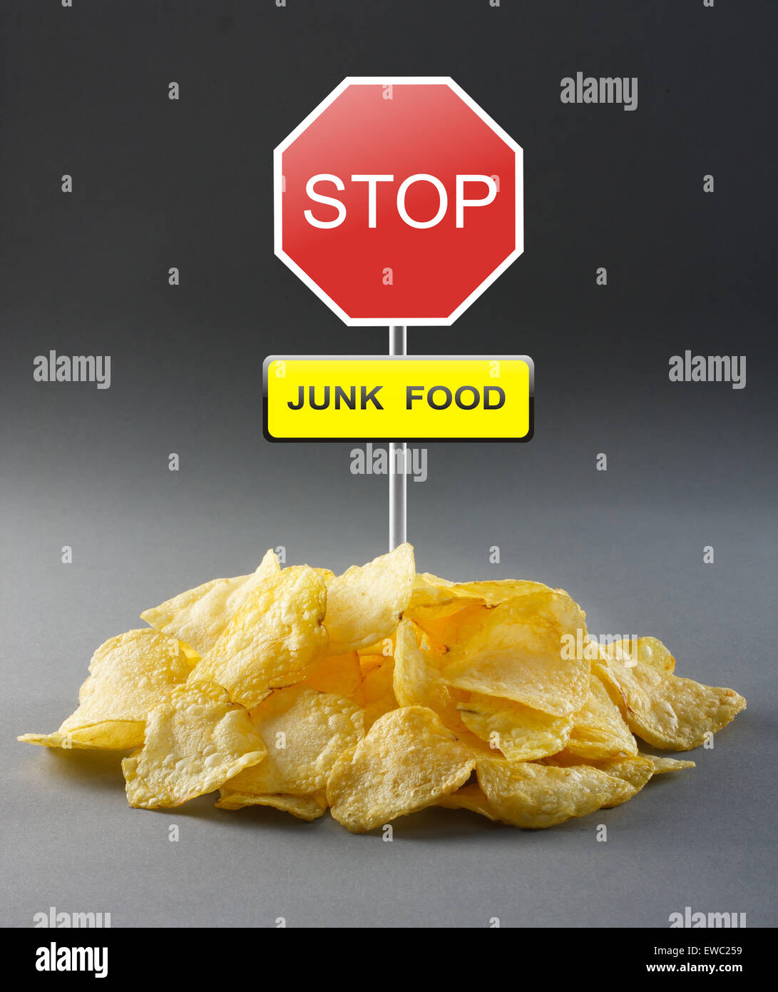 Junk food concept - potato chips and road stop sign - Stock Image
