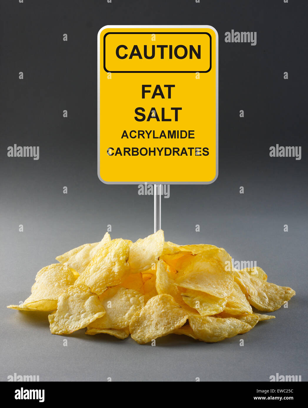 Junk food concept - potato chips - Stock Image