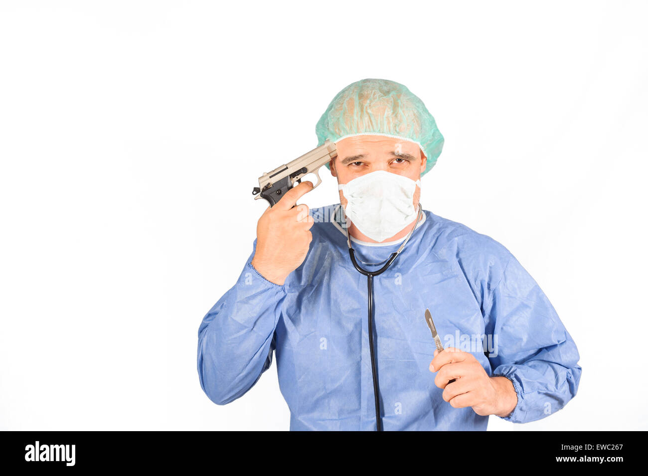 Surgeon planning to suicide, gun on his head isolated on white background - Stock Image