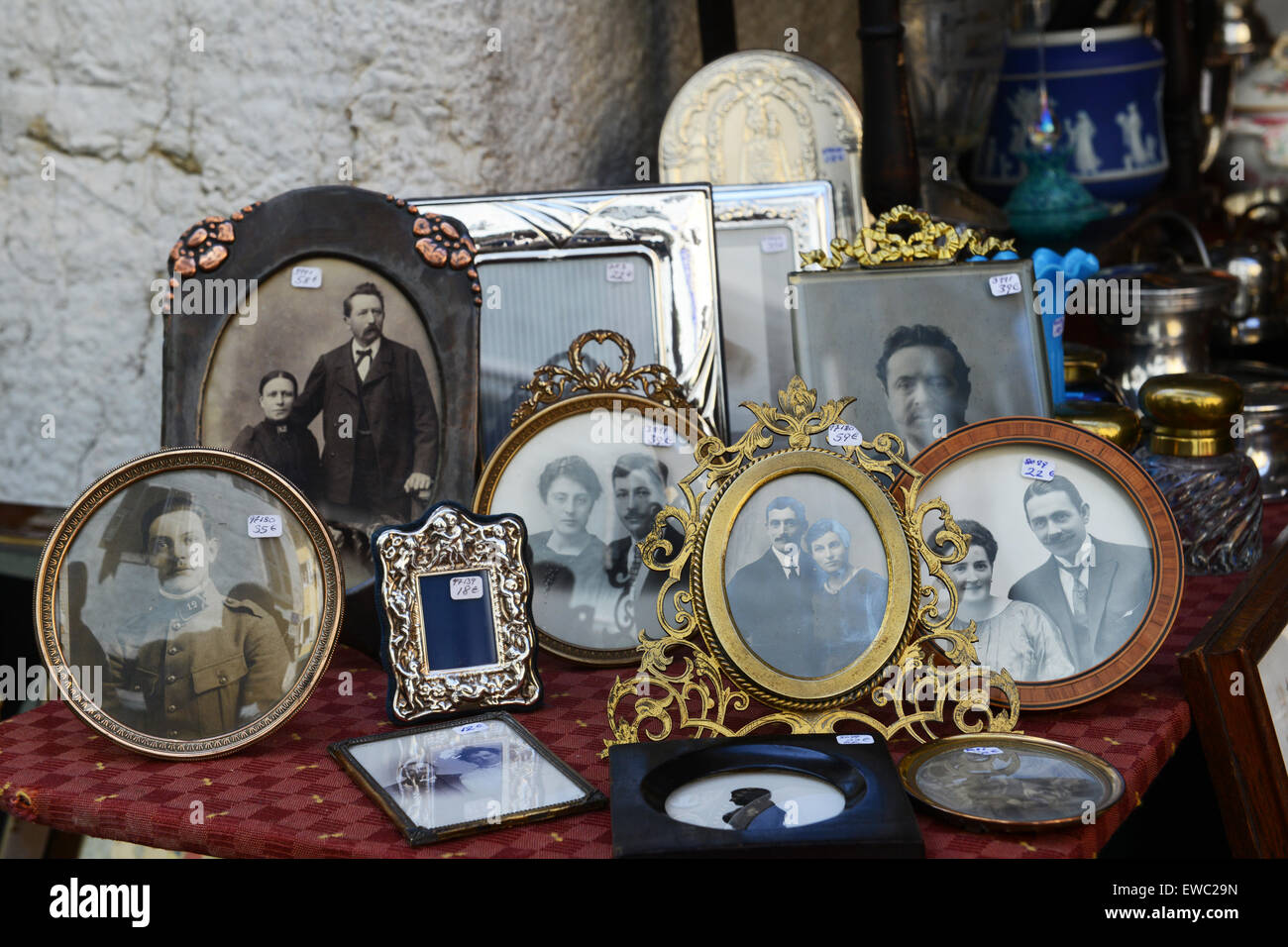 Old family portraits photographs for sale at Market - Stock Image