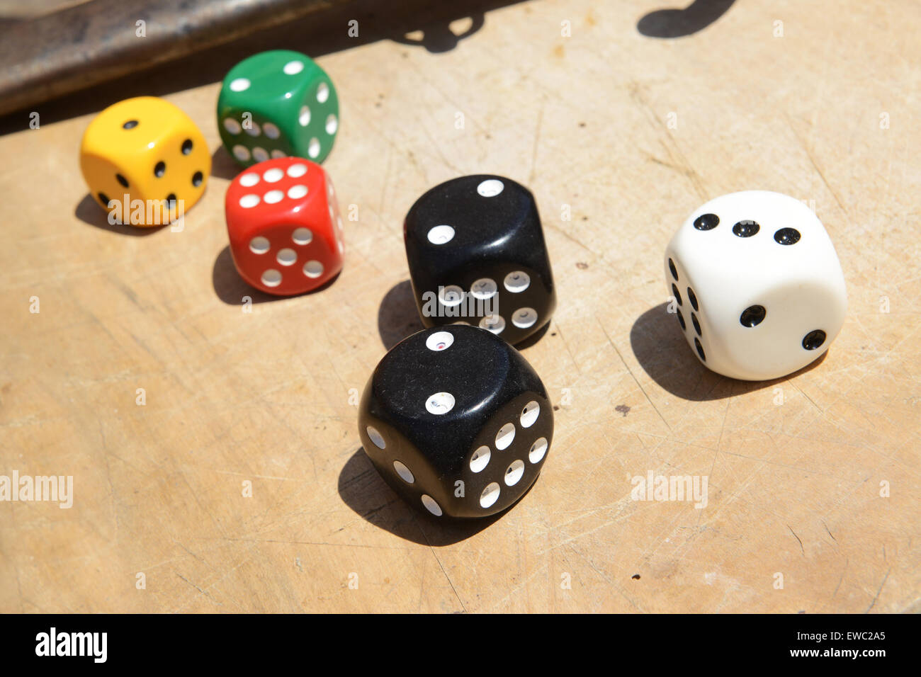 Dice dices coloured colourful color colored throw of the - Stock Image