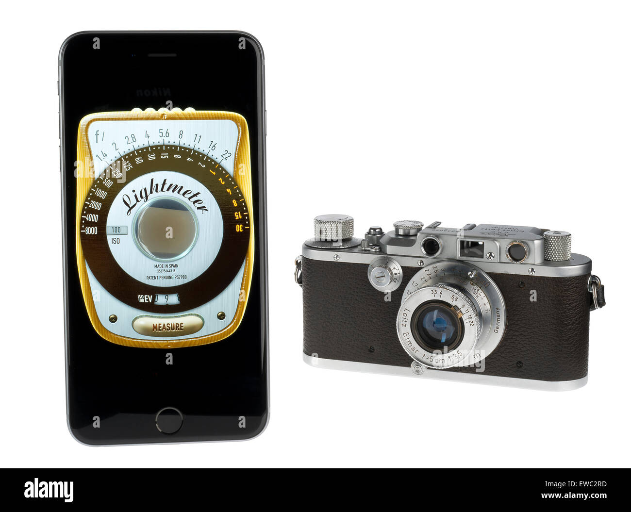 Old Leica camera and a modern light meter application on a smartphone. - Stock Image