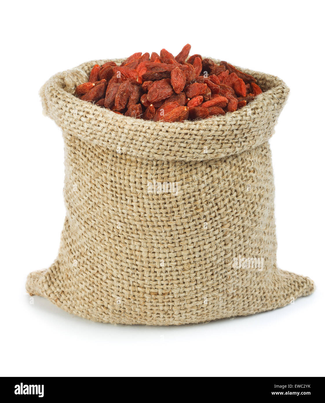 Dried goji berries in burlap bag. - Stock Image