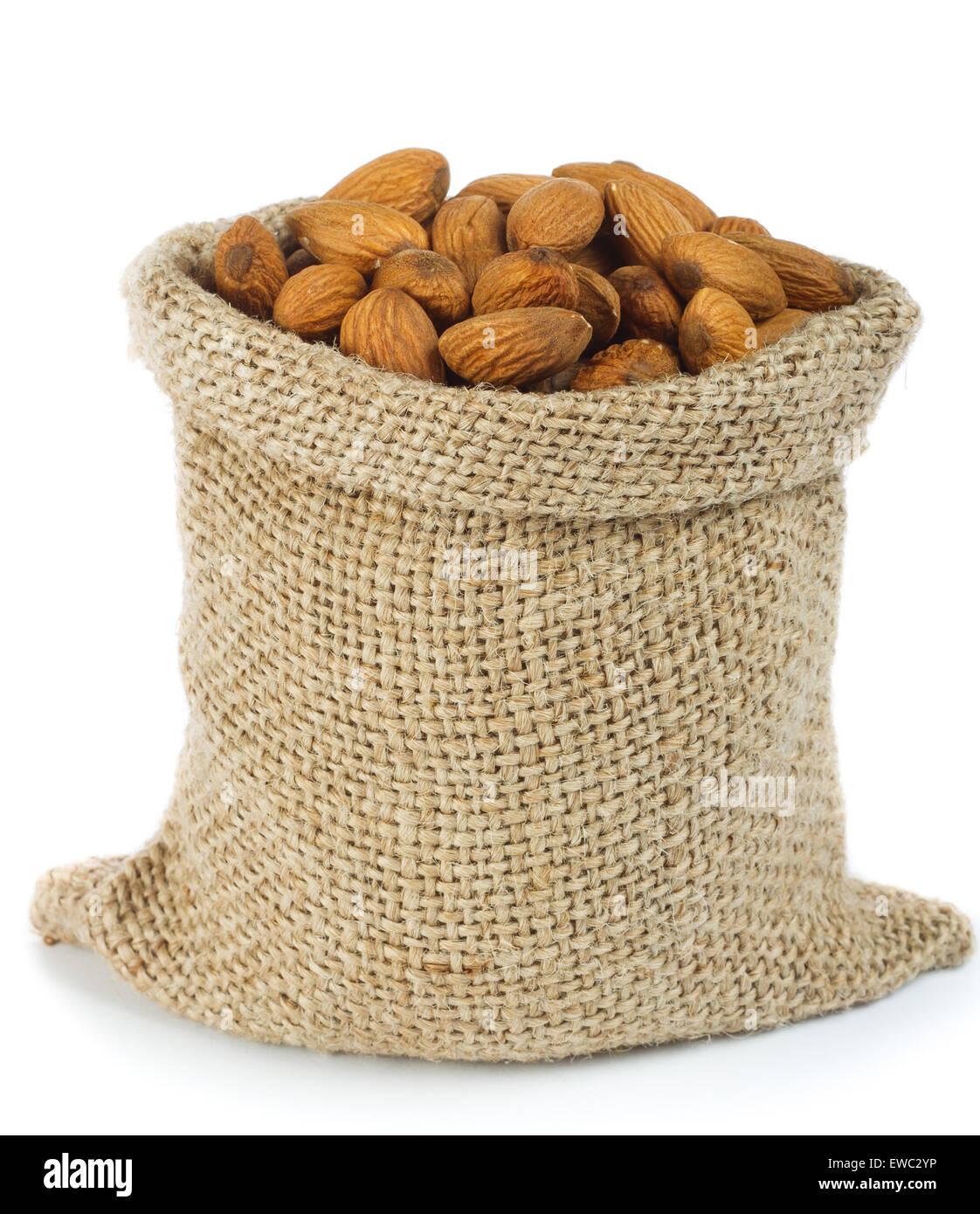 Almonds in burlap bag - Stock Image