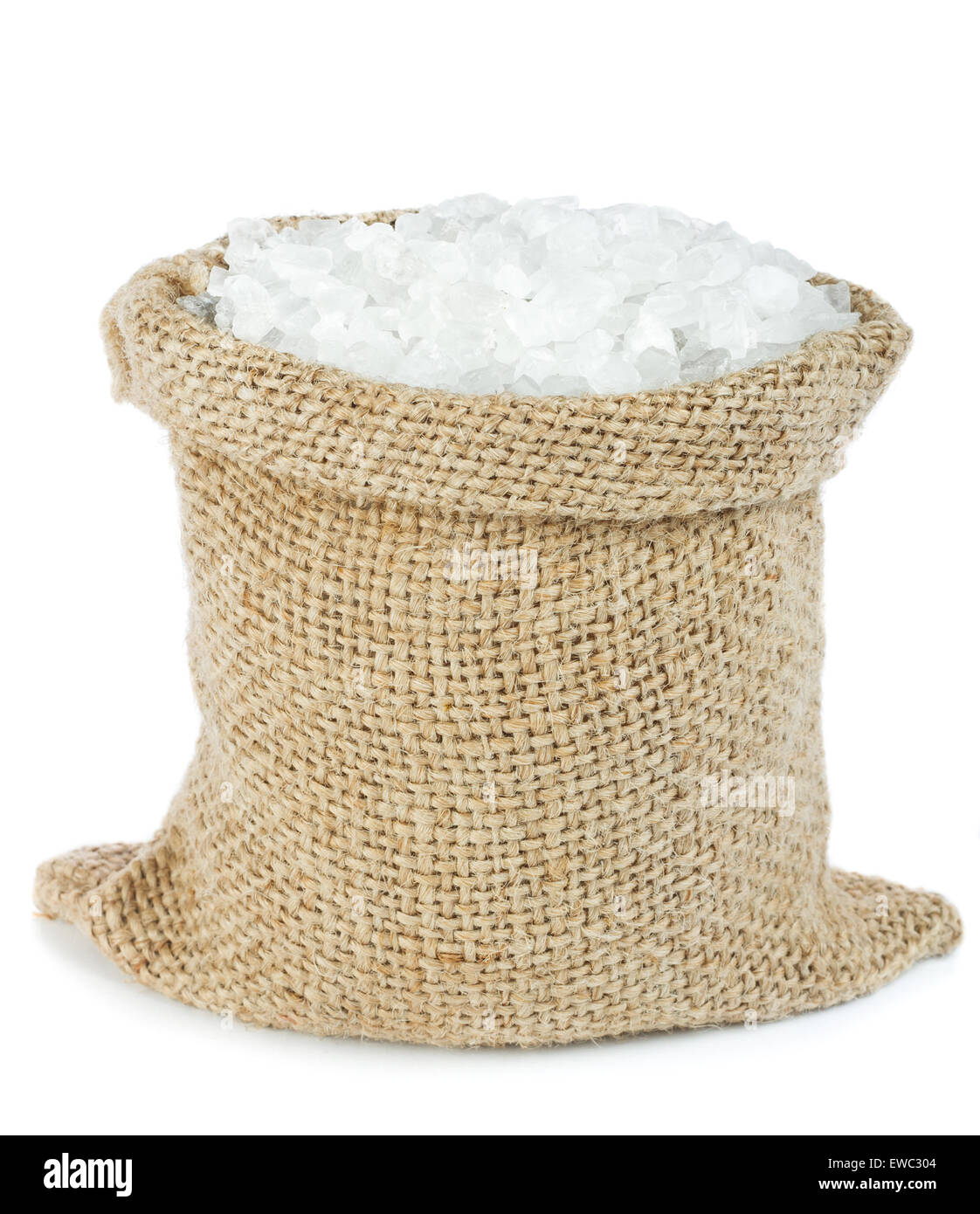 Sea salt crystals in burlap bag - Stock Image