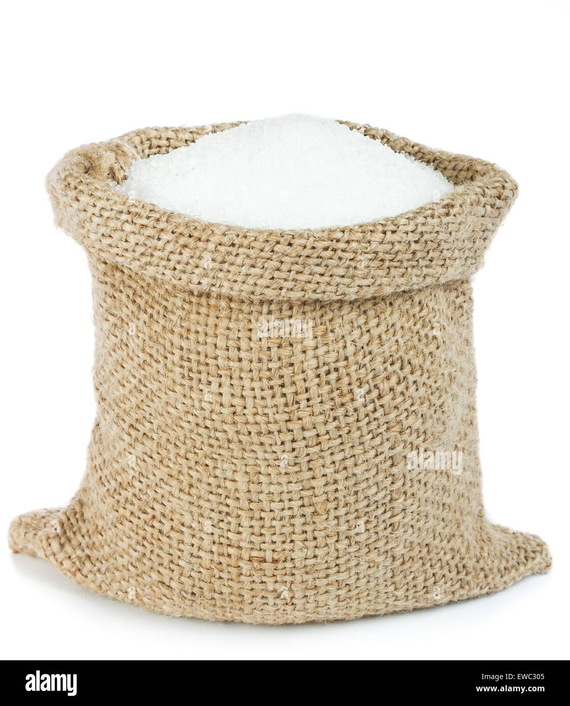 White sugar in burlap bag - Stock Image